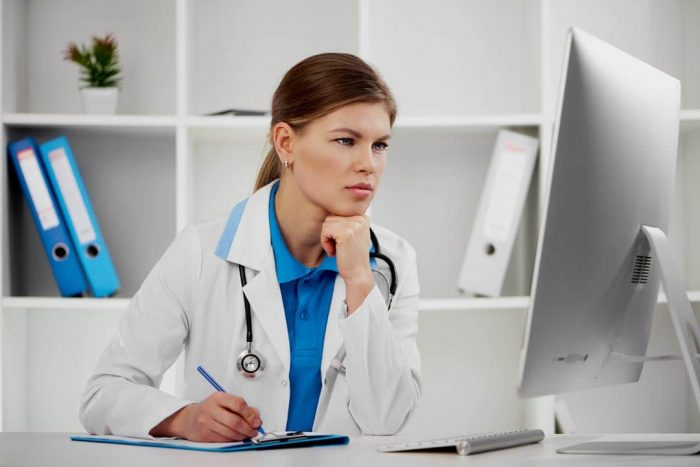 Doctor performing grading an Online Medical Evaluation